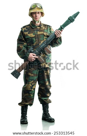 Soldier in camouflage with a weapon - stock photo