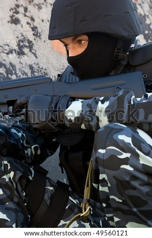 Soldier in full ammunition with automatic rifle - stock photo
