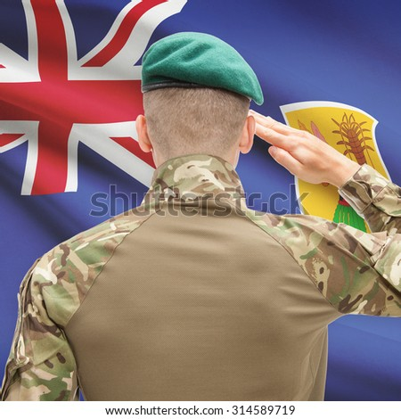 Soldier in hat facing national flag series - Turks and Caicos Islands