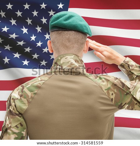 Soldier in hat facing national flag series - United States - stock photo