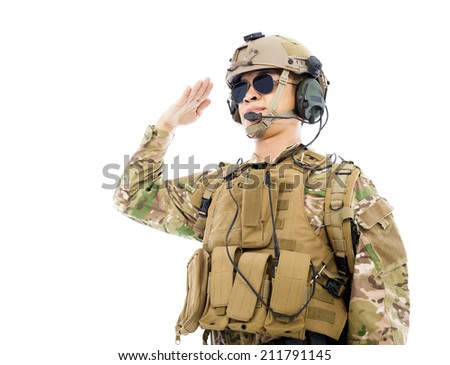 Soldier in military uniform  saluting over white background - stock photo