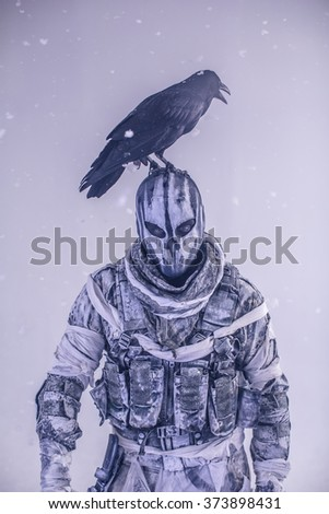 Soldier in the mask is a crow on his head with a crossbow in his hands. The post Apocalypse. Fantastic.