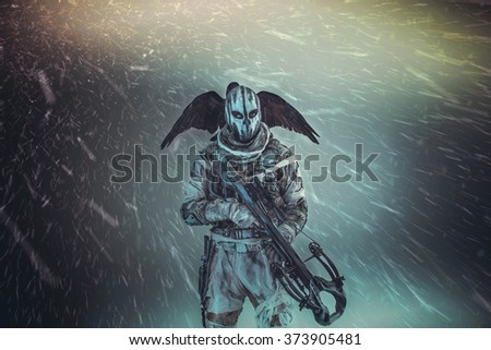 Soldier in the mask is a raven and a crossbow. - stock photo
