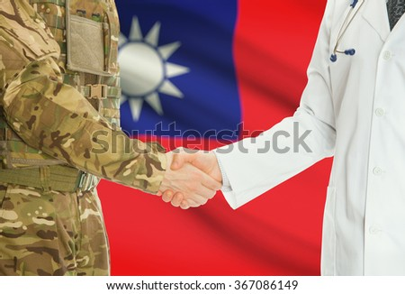 Soldier in uniform and doctor shaking hands with national flag on background - Taiwan - stock photo