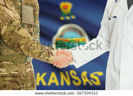 Soldier in uniform and doctor shaking hands with US states flags on background - Kansas - stock photo