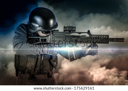 Soldier in uniform with rifle, assault sniper on apocalyptic clouds, firing - stock photo