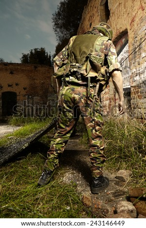 Soldier making bed - stock photo
