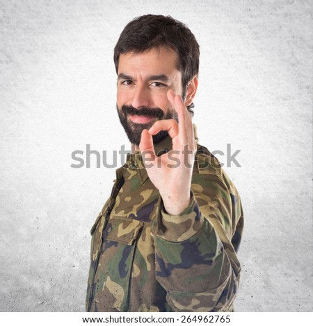 Soldier making Ok sign  - stock photo