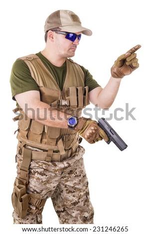 Soldier man holding his gun. - stock photo