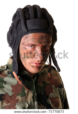 Soldier masked with camouflage paints