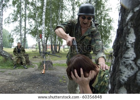 Soldier mocking woman