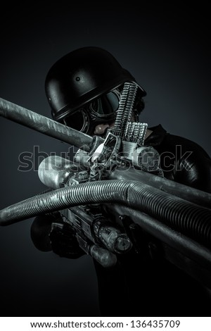 soldier of the future with huge laser gun and cannon, pointing - stock photo