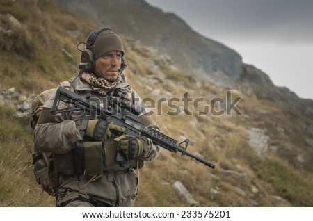 Soldier on patrol during Mountain operations - stock photo