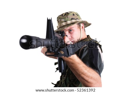 Soldier pointing rifle - stock photo