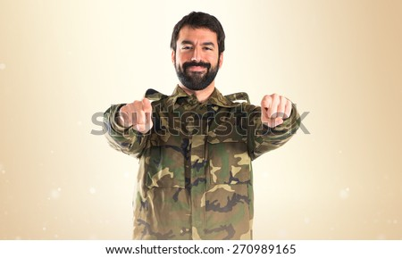 Soldier pointing to the front  - stock photo