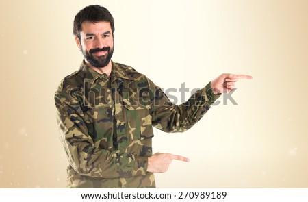 Soldier pointing to the lateral  - stock photo
