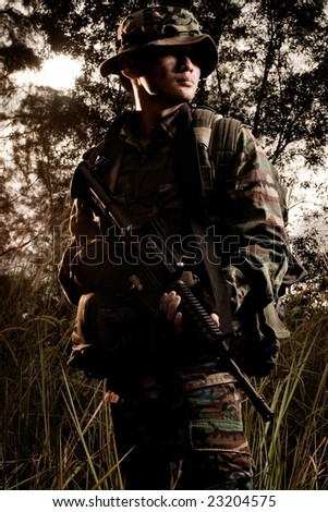 soldier portrait in the jungle - stock photo