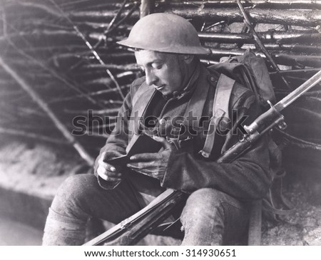 Soldier reading a book - stock photo