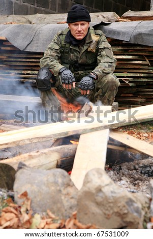 Soldier resting at the bonfire ( campfire )