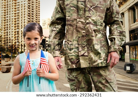 Soldier reunited with his daughter against new york street - stock photo
