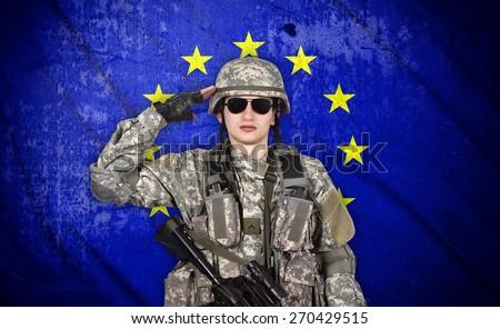 soldier salutes the European Union flag on the background - stock photo