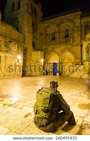 Soldier seating on square of main entrance in at the Church of the Holy Sepulchre in Old City of Jerusalem - stock photo