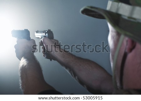 Soldier shooting with guns.