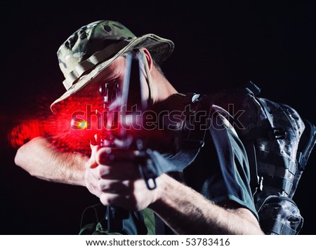 Soldier shooting with laser gun. - stock photo