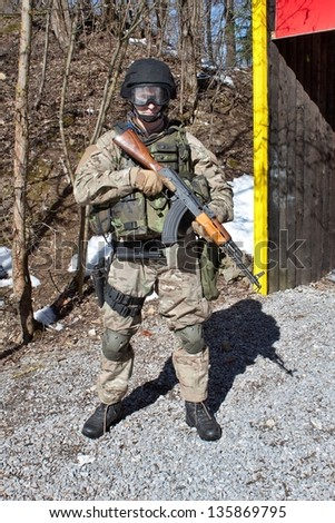 soldier special counterterrorism unit, AK-47 with an assault rifle, caliber 7.62 mm - stock photo