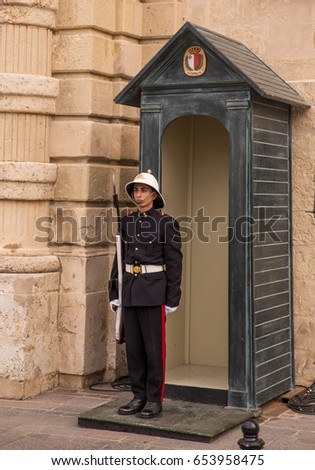 Soldier standing on guard in front of Armory Palace - Valletta Malta may 2017