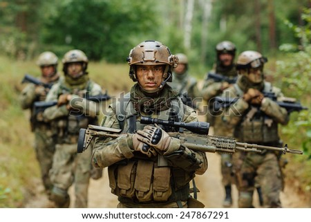 soldier stands with arms together with other - stock photo