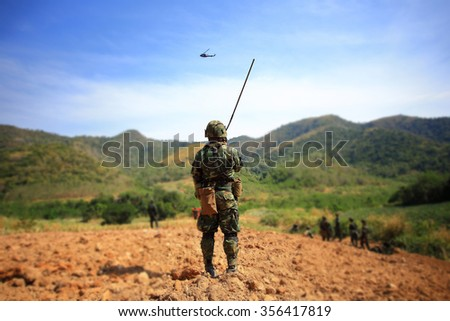Soldier talking portable radio - stock photo