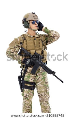 Soldier talking portable radio station. isolated on white background - stock photo