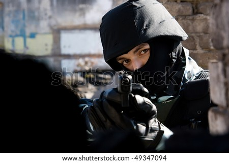 Soldier targeting with a semi-automatic pistol - stock photo