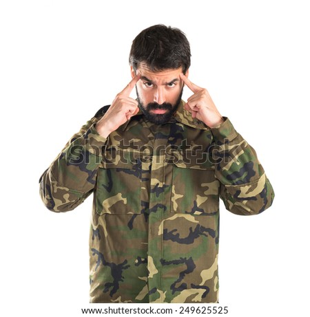 Soldier thinking over white background   - stock photo