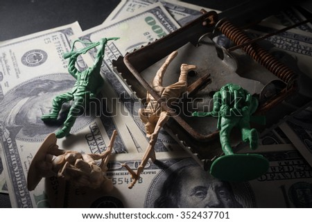 Soldier toys with mouse trap on money. - stock photo