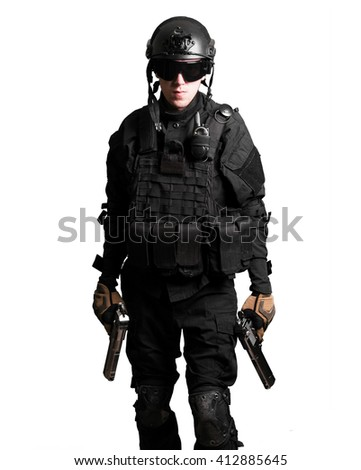 Soldier wearing black suit with double guns isolated - stock photo