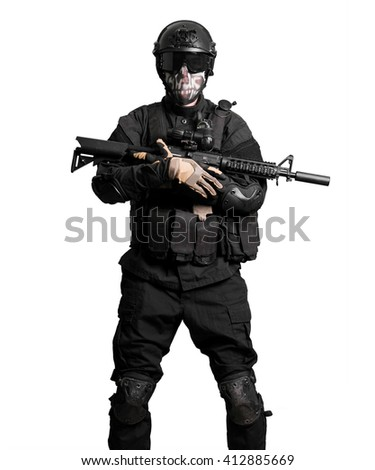 Soldier wearing black suit with m4 isolated - stock photo