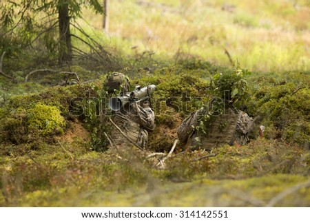 soldier with a grenade launcher in the trenches - stock photo