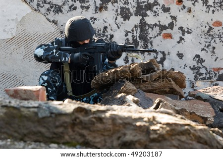 Soldier with a gun in the hideout place - stock photo