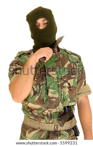 soldier with a military mask holding knife - stock photo
