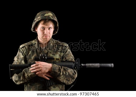 Soldier with a rifle in the hands - stock photo