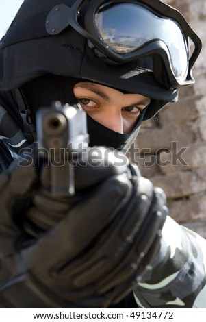 Soldier with a semi-automatic glock pistol targeting - stock photo
