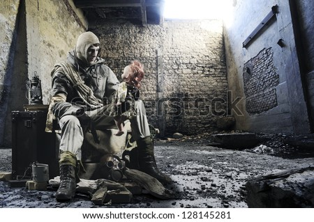 Soldier with an old doll in hand in the ruins