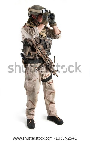 Soldier with binoculars against white background. Full body. - stock photo