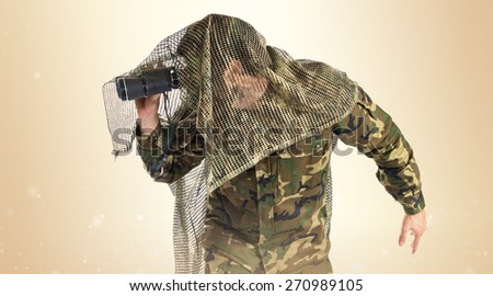 Soldier with binoculars over white background   - stock photo