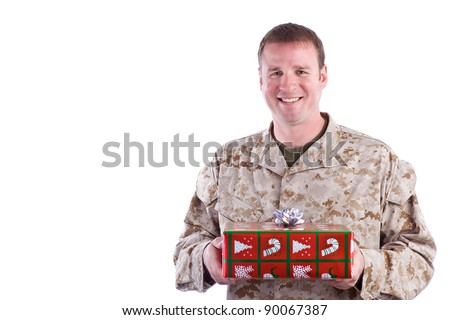 Soldier with Christmas Gift - stock photo