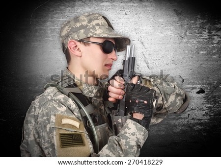 soldier with gun on a gray background