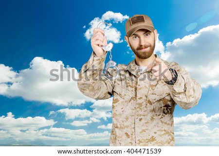 Soldier with handcuffs - stock photo