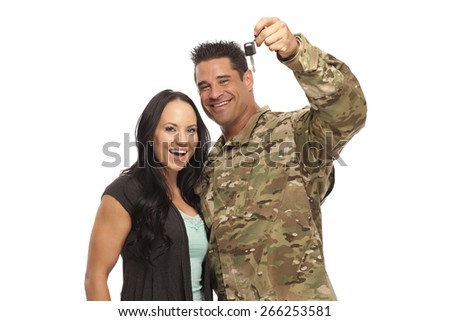 Soldier with his wife holding new car key - stock photo